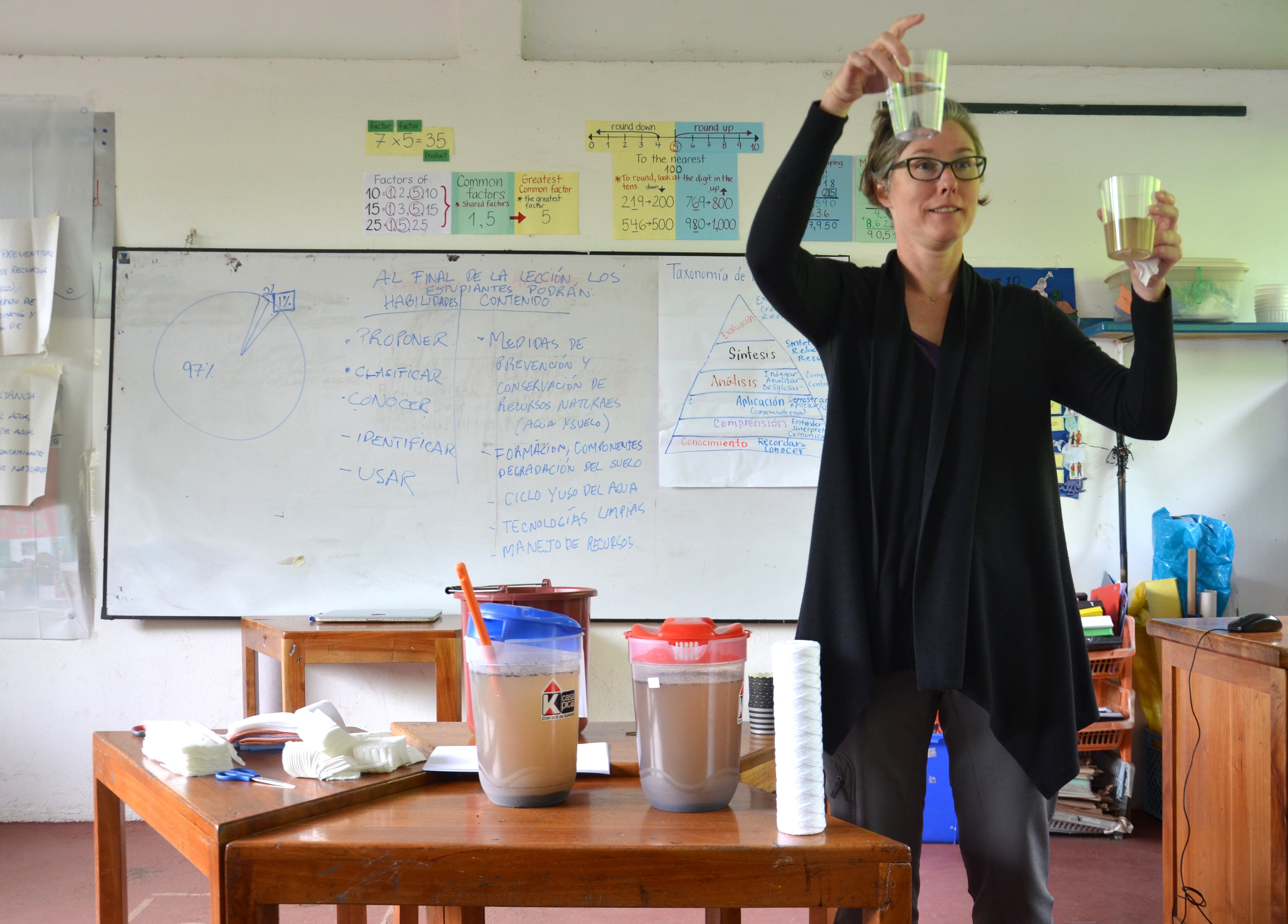 KC Busch displays the result of a water filtration experiment in the Galapagos Islands