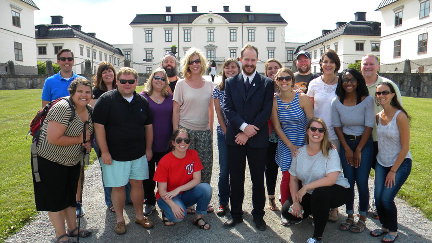 A group of in-service teachers pose during a previous overseas professional development trip