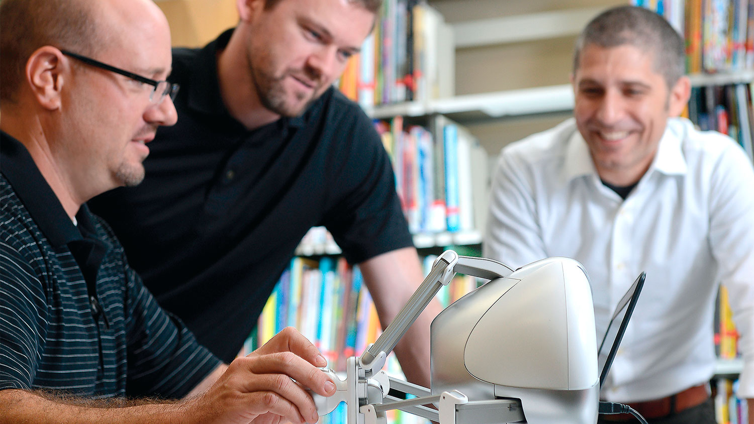 Researchers working with robot