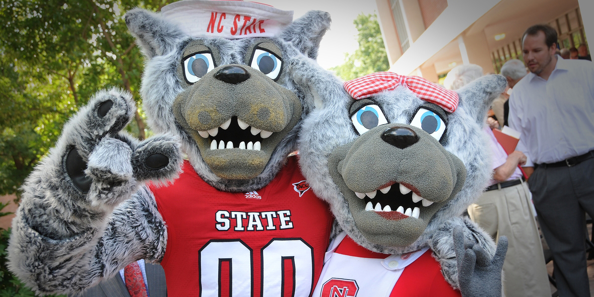 Mr. and Mrs. Wuf attend the groundbreaking ceremony.