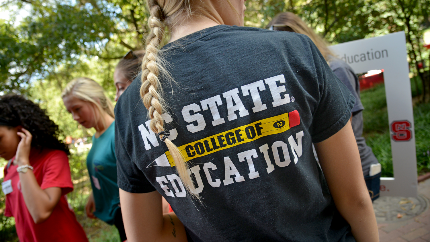 A student wearing a College of Education T-shirt