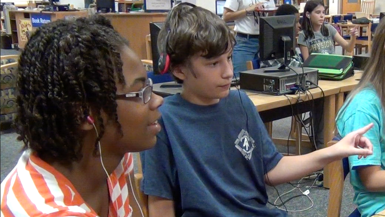 Students at Reedy Creek Middle School interacting with Wiebe's computer game.