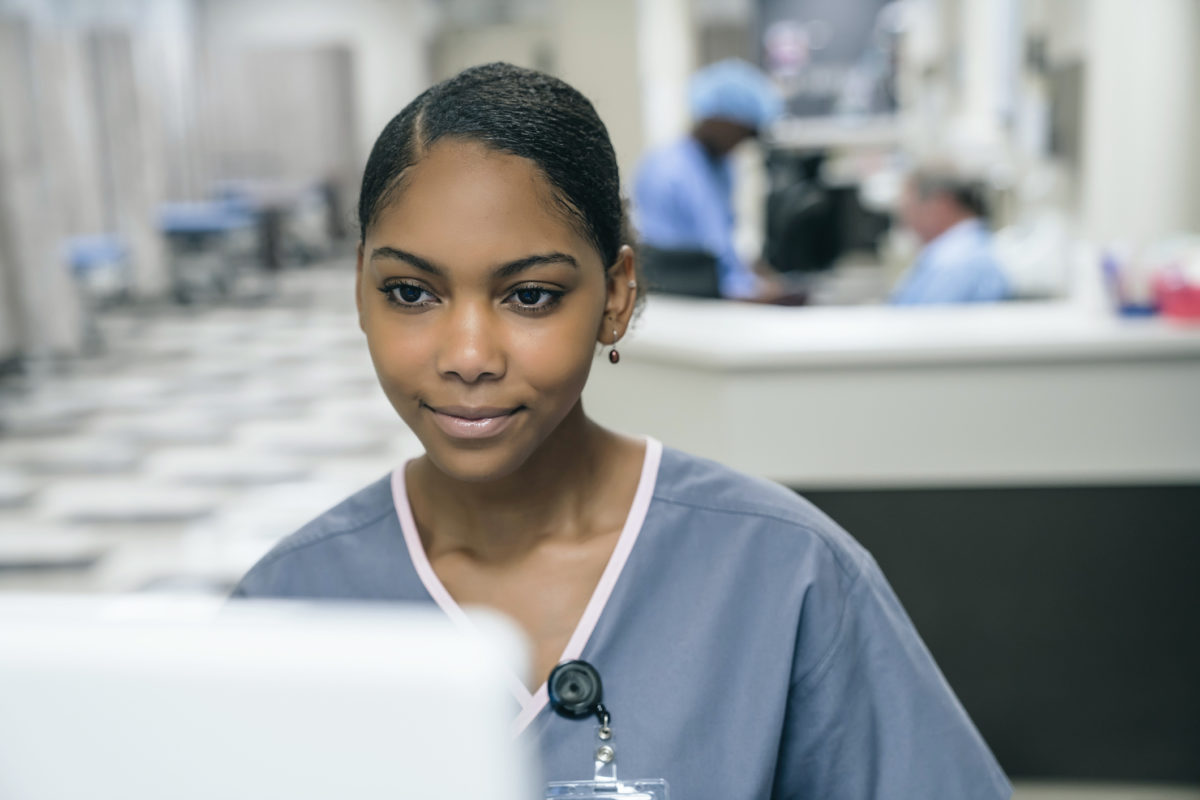 A photo of a nurse using a computer