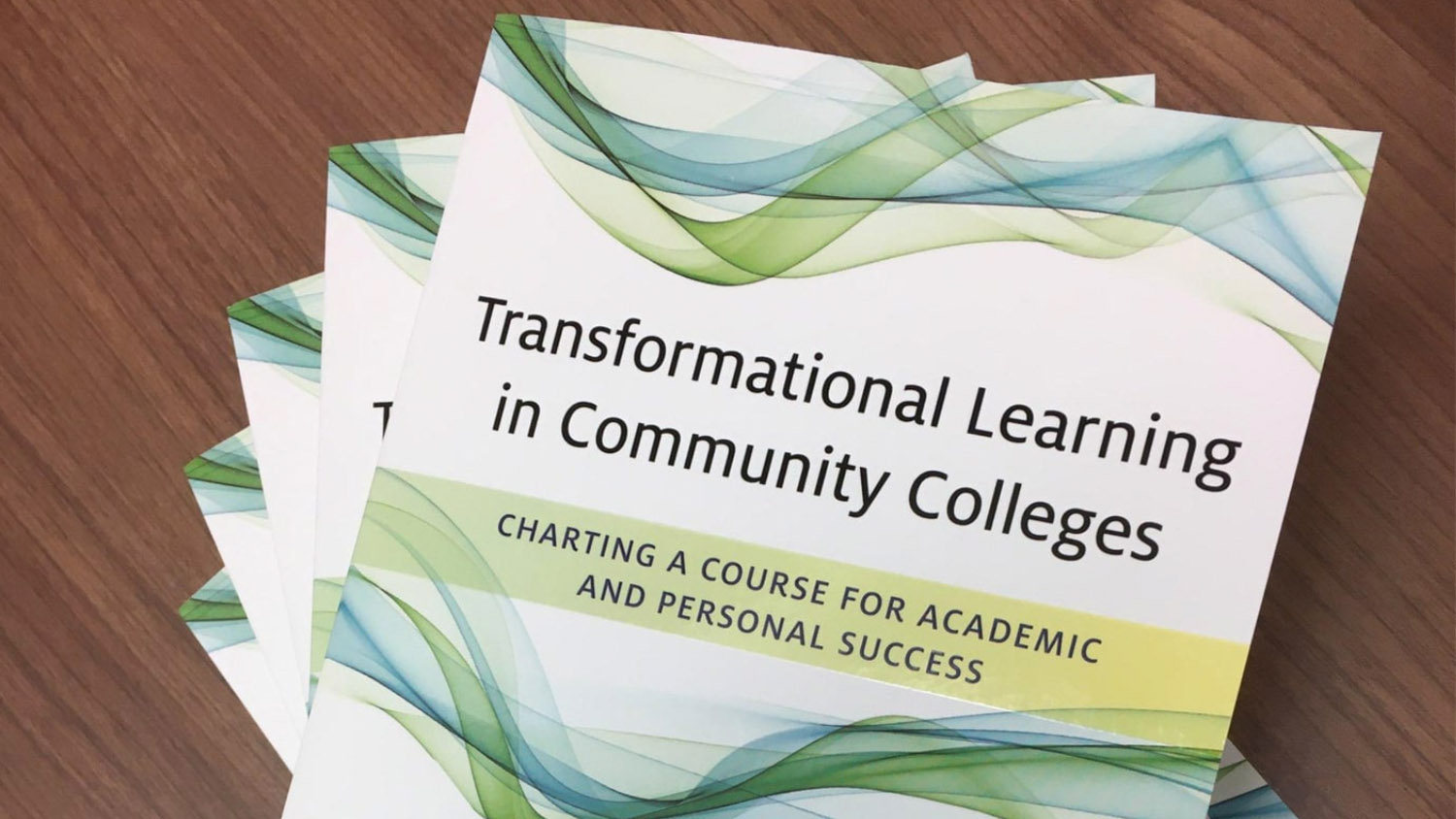 Several copies of Transformational Learning in Community Colleges: Charting a Course for Academic and Personal Success, a new book co-authored by Chad Hoggan, Ed.D.