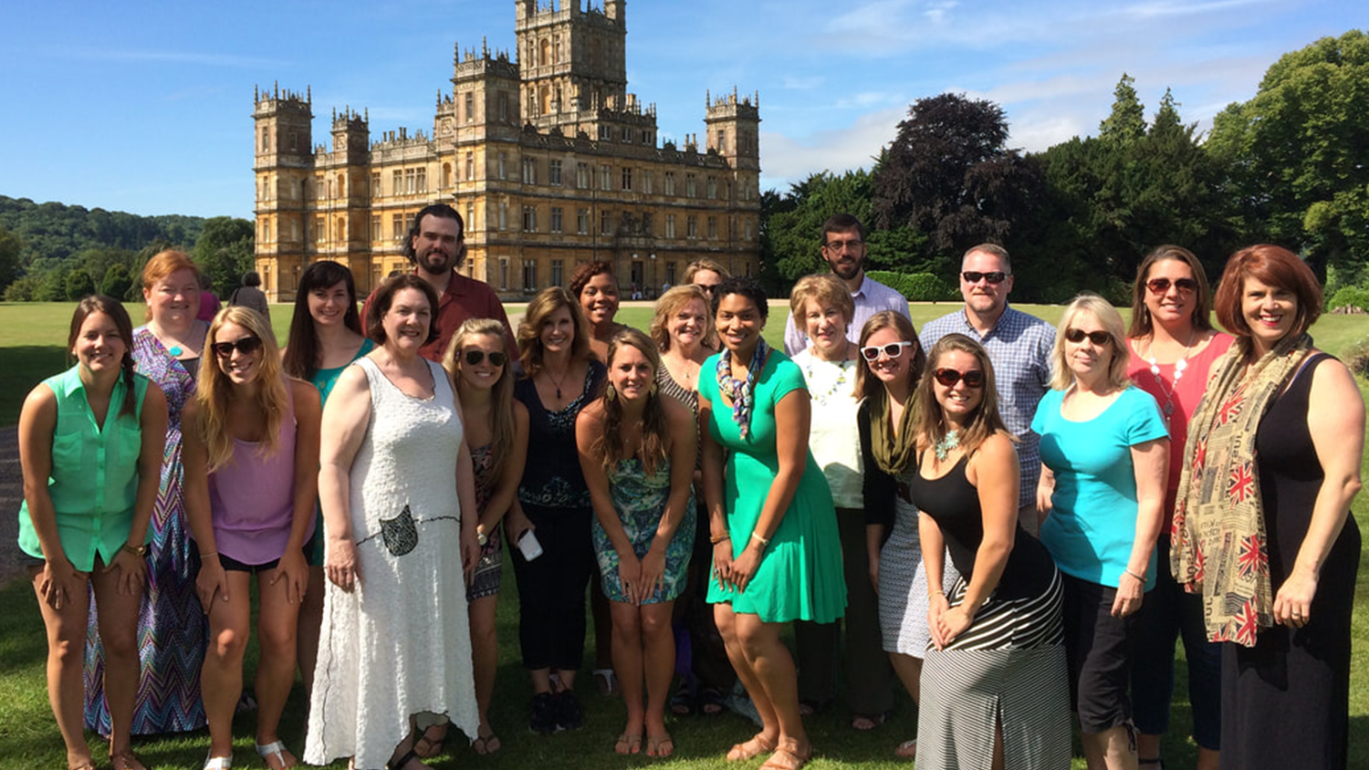 A group of in-service teachers stand in front of a castle on a previous overseas professional development trip.