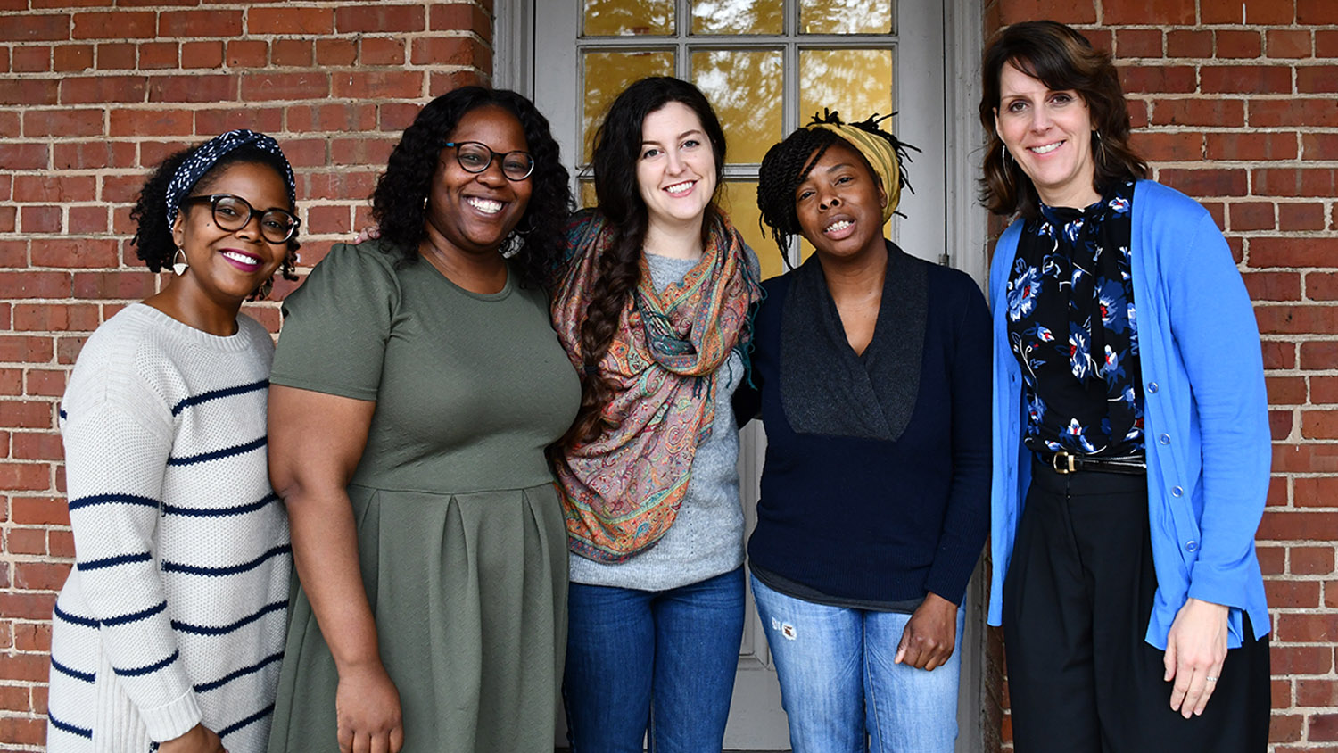 Angela Wiseman stands with Qiana Cryer-Coupet and graduate students