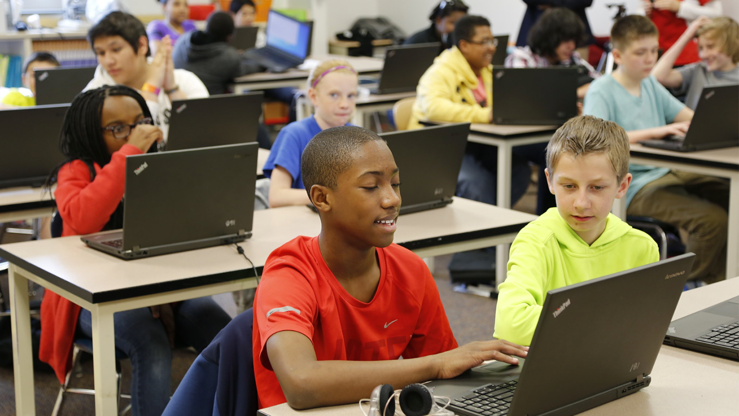 A group of children learn with computers