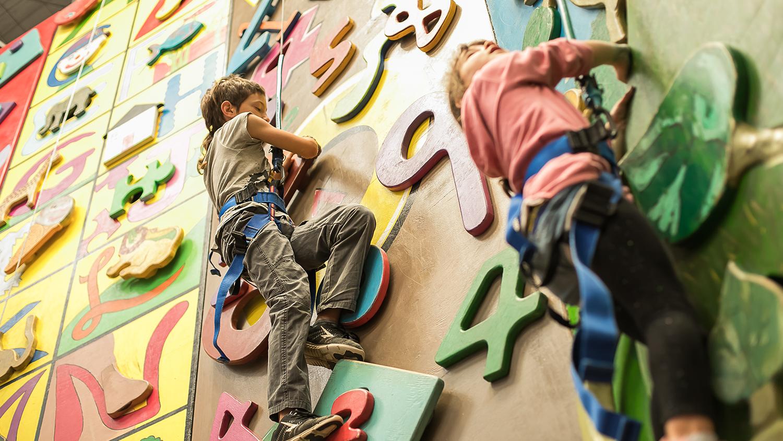 Kids climbing a wall