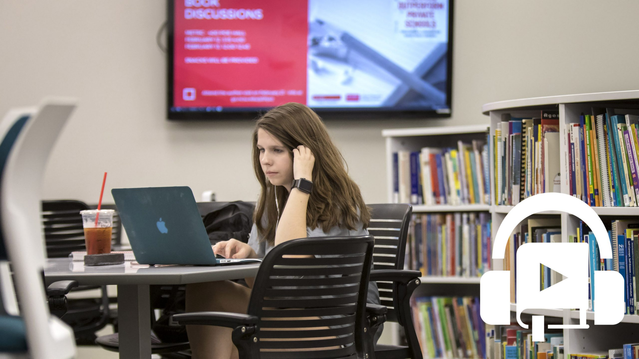 A student sitting in METRC listening to an audiobook