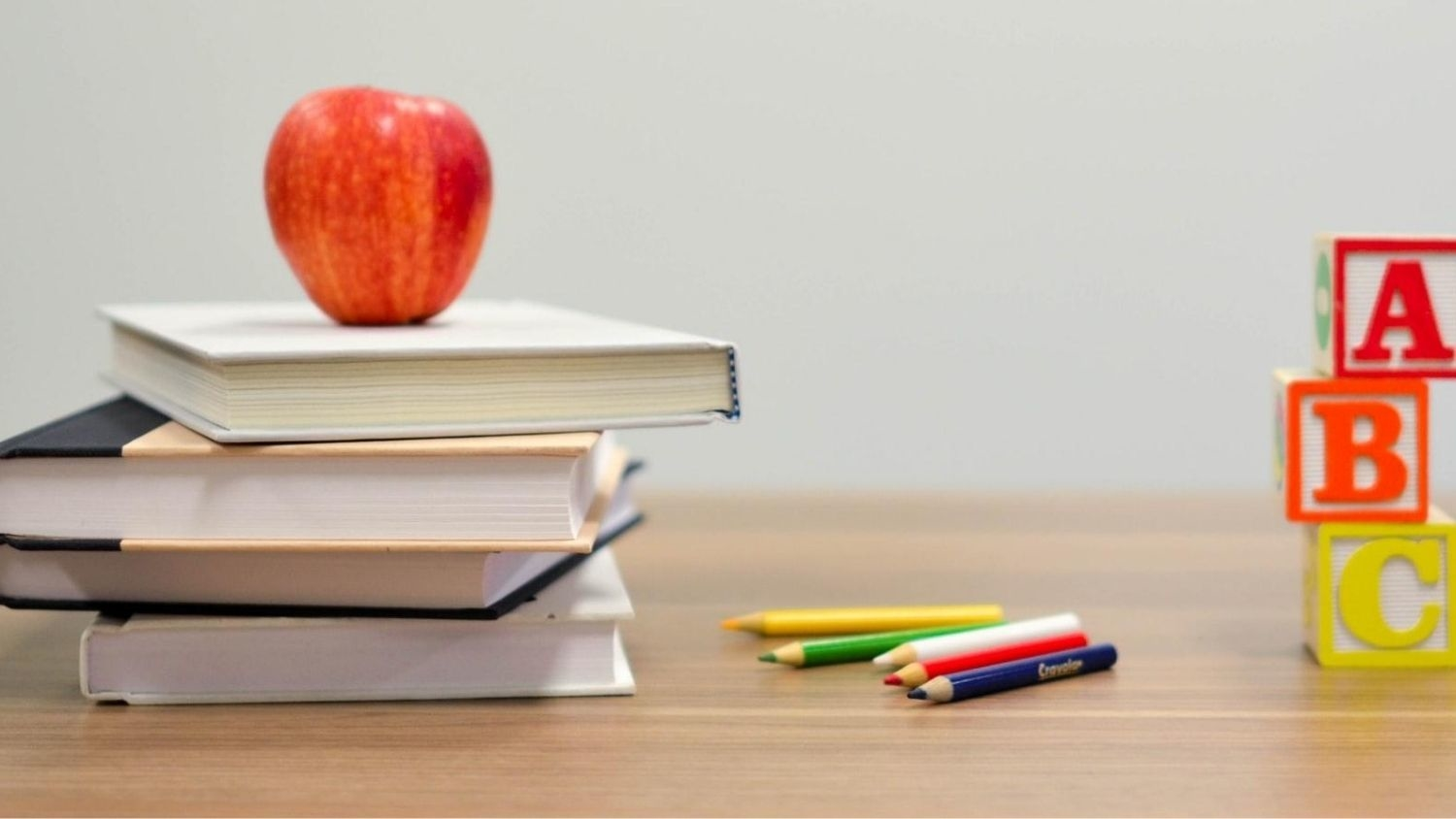 Apple on books in classroom.