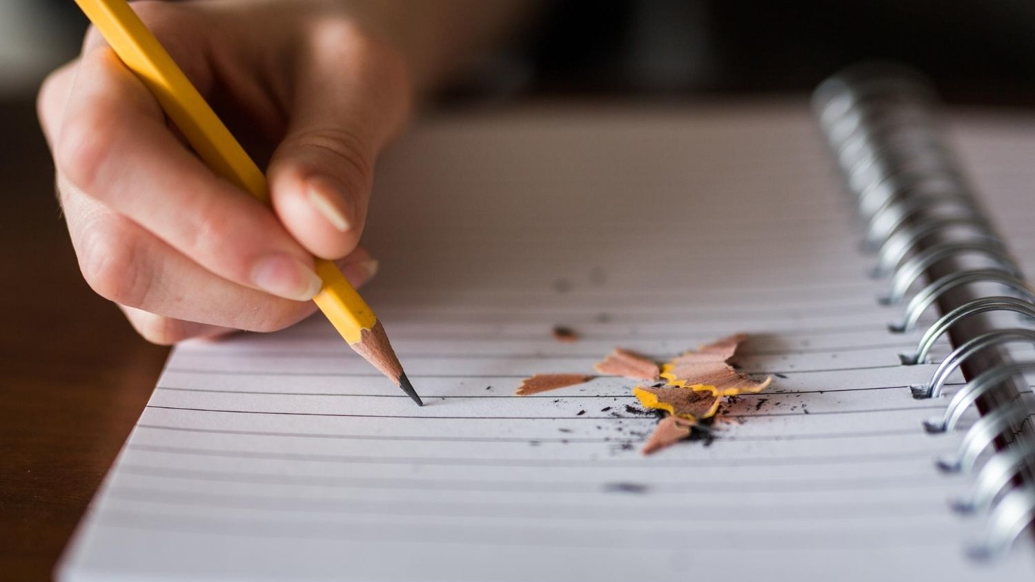 Writing with a pencil.