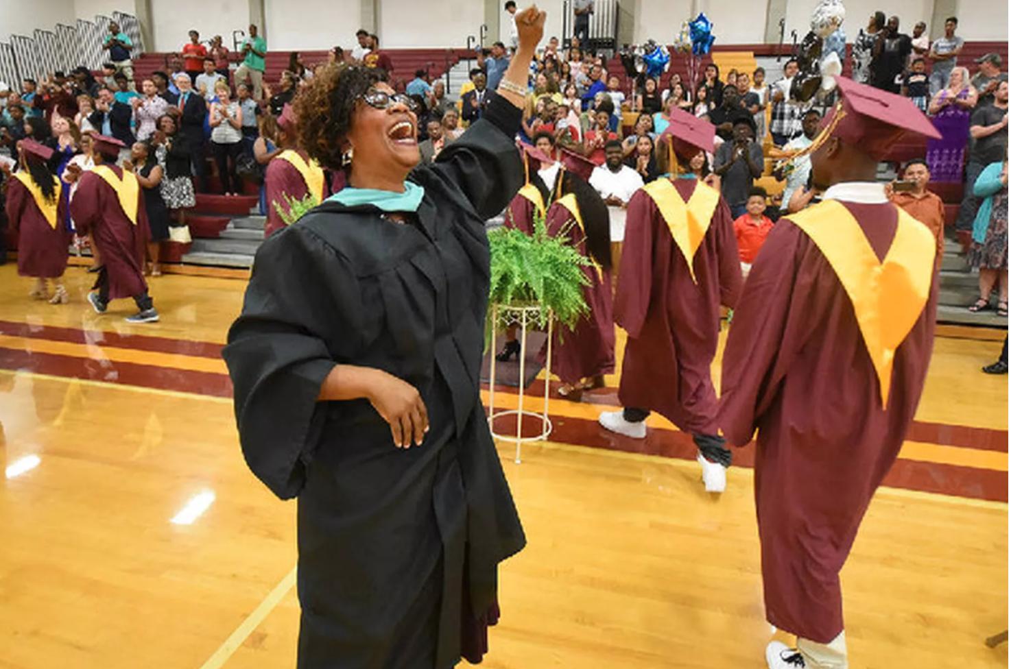 A school principal at a graduation ceremony