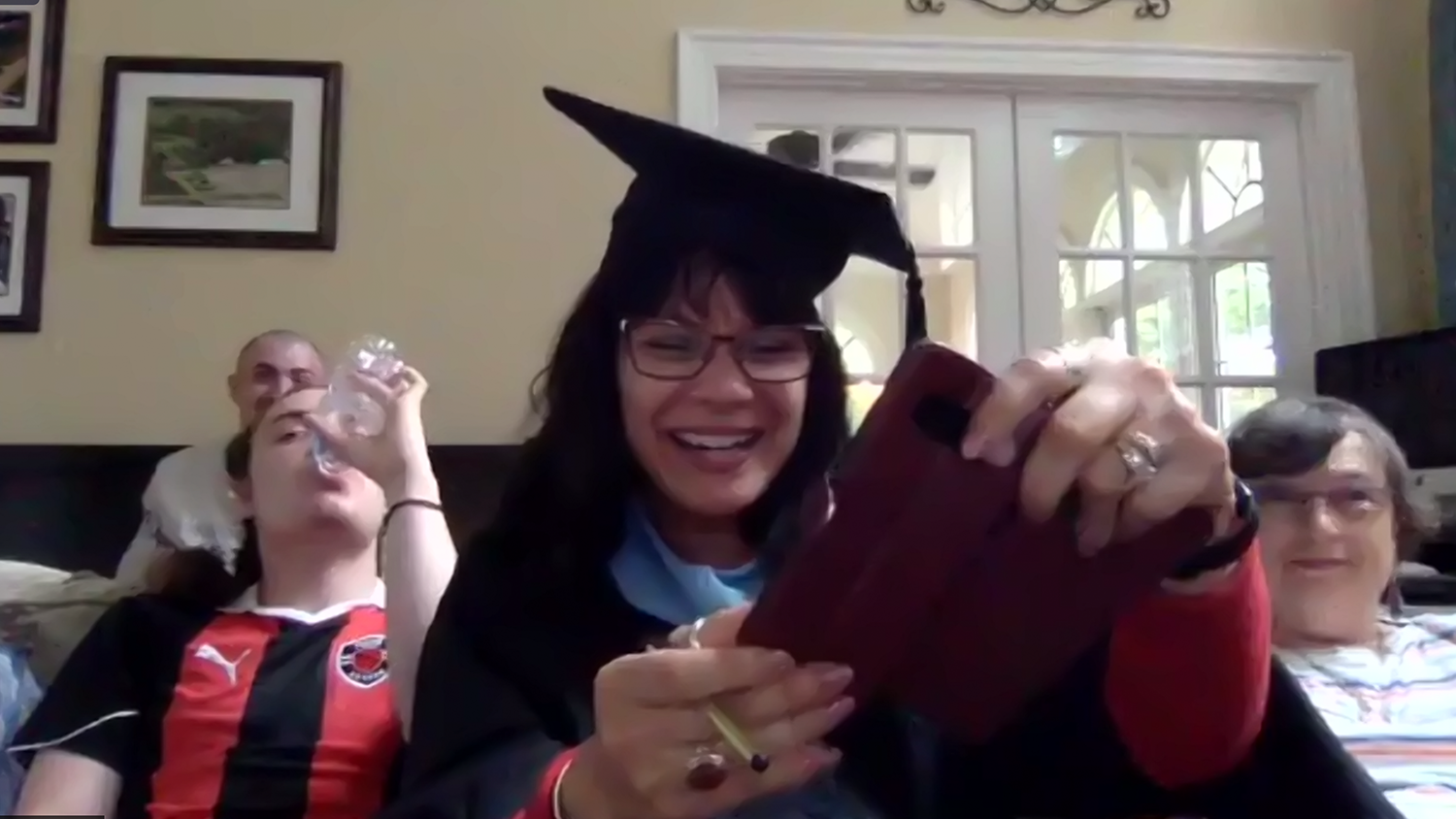 NC State College of Education graduate Zorida Bennett with her family during the Virtual Graduation Ceremony on May 14, 2021