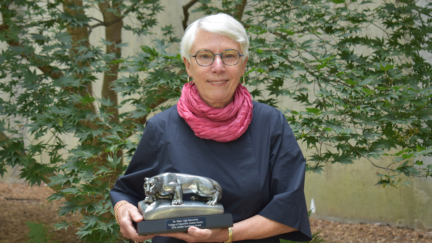 Mary Ann Danowitz holding Penn State College of Education's Alumni Excellence Award