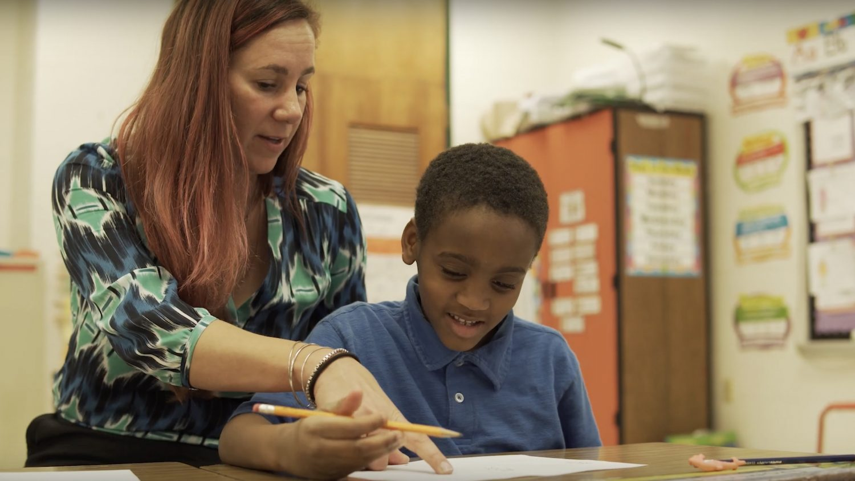 Teacher Helping a Student Read