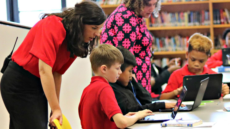 A principal with students at a public school in North Carolina.