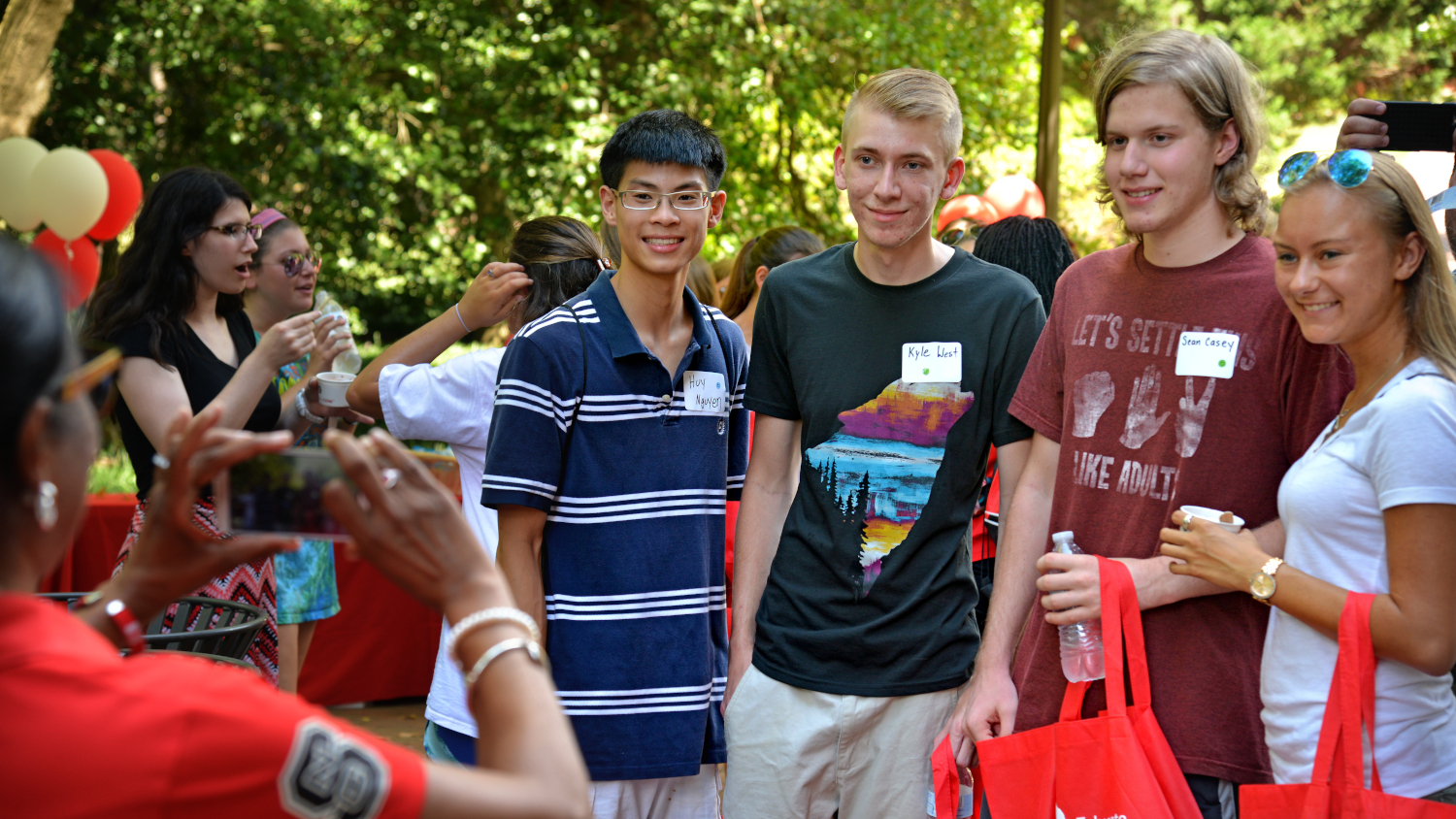 College of Education students pose for a photo during Wolfpack Welcome Week celebration outside Poe Hall.