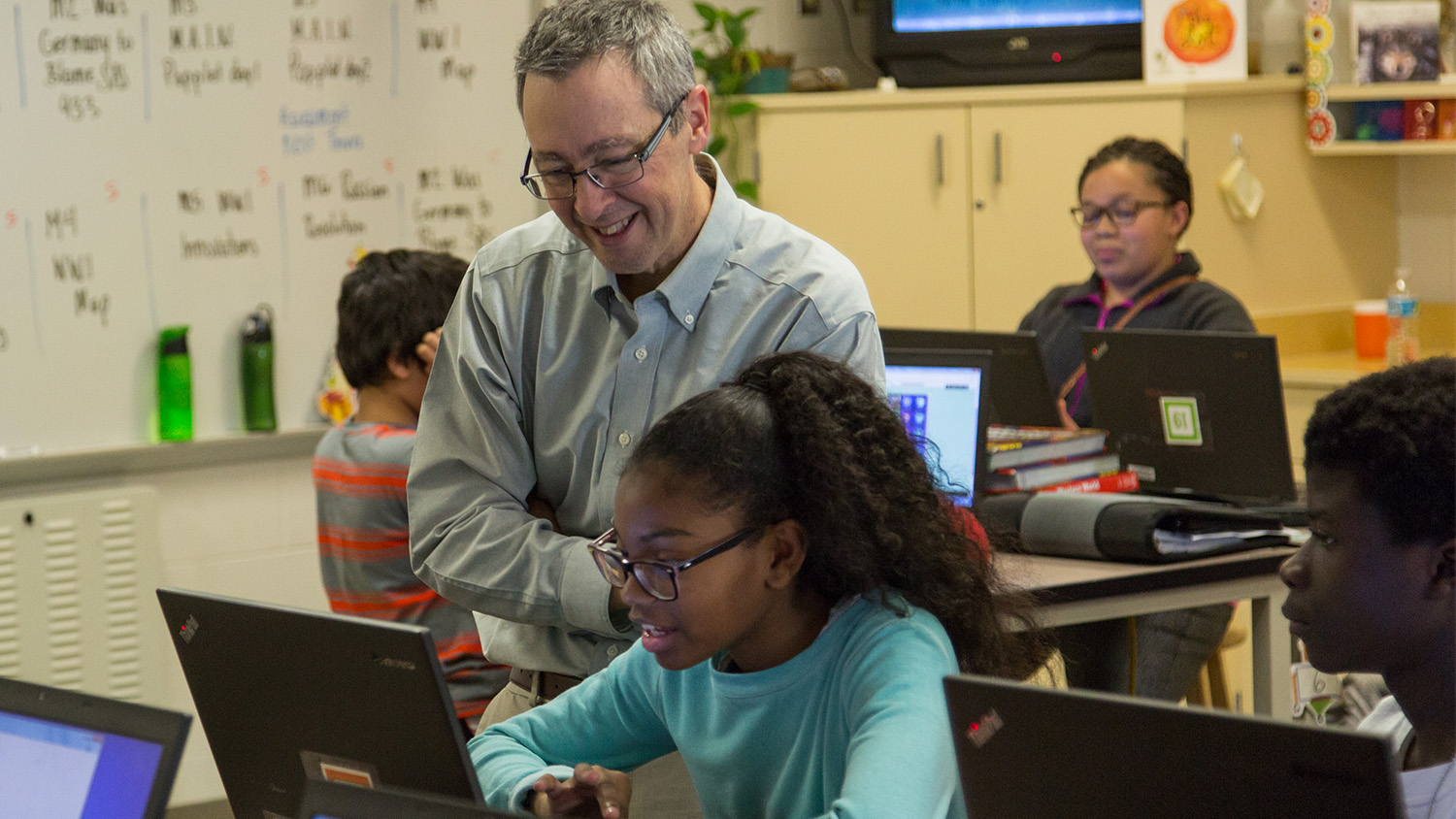 NCState College of Education Professor and Friday Institute Fellow Eric Wiebe works with students at Centennial Campus Middle School.