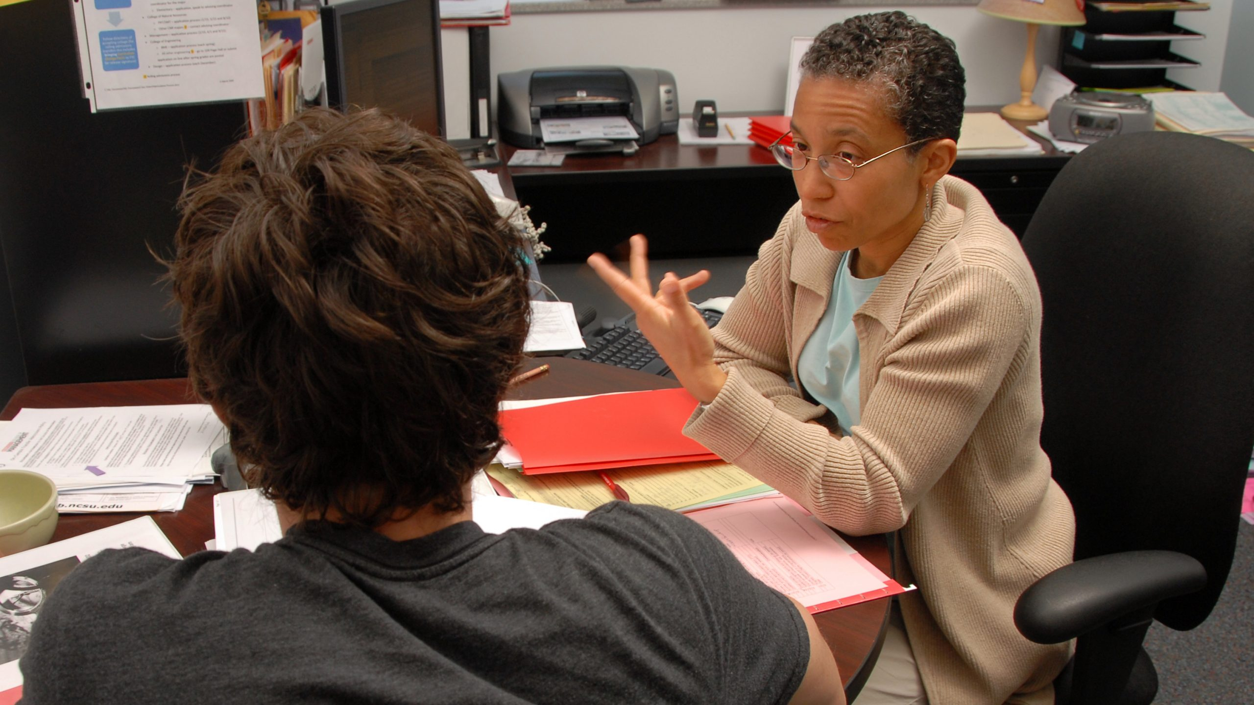 Academic advisor meeting with a student