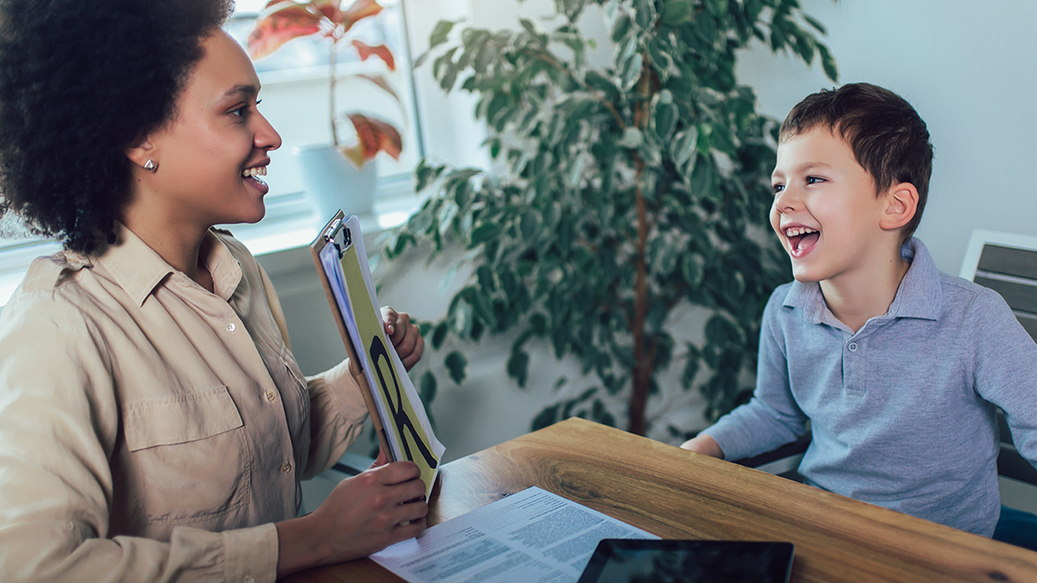 Shot of a speech therapist during a session with a little boy