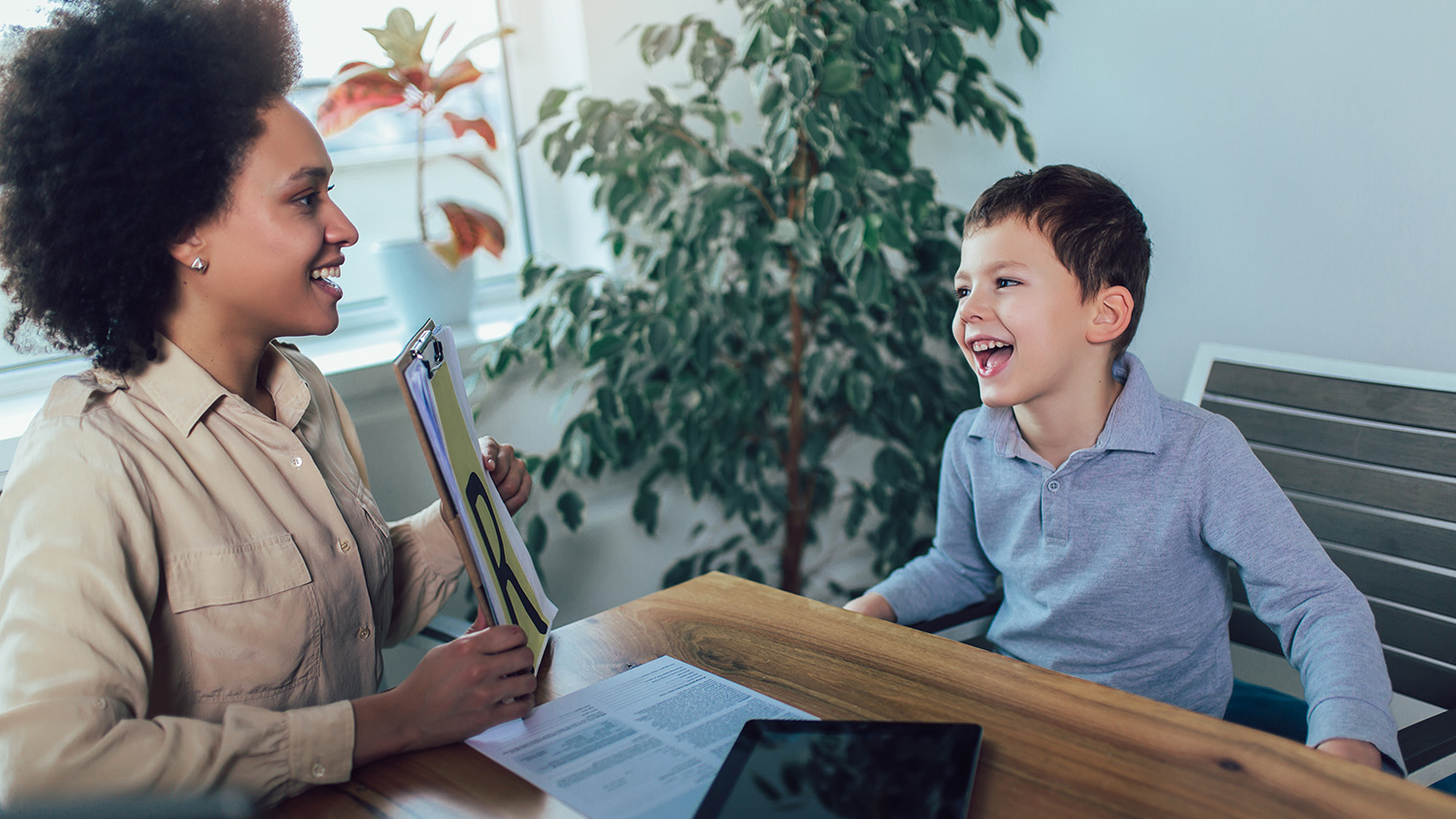 Speech therapist during a session with a little boy
