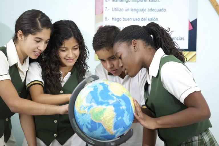Students looking at globe