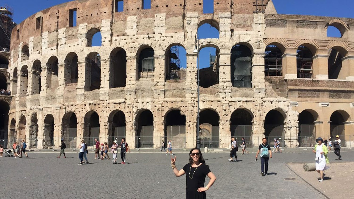 College of Education student Kelsi Harris poses in front of the Colosseum in Rome.