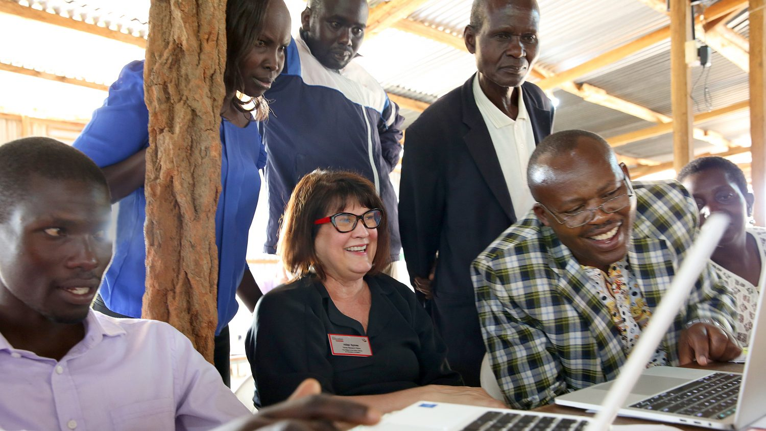 A photo of Dr. Hiller Spires and Kenyan educators at computers