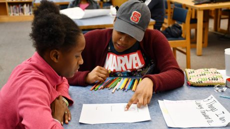 A photo of NC State Education student Sydney Reid during a SAY Village mentoring session