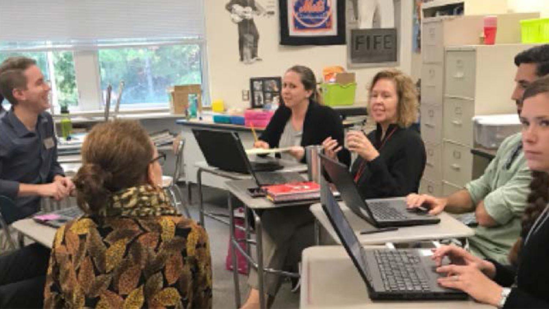 Teachers in a classroom meeting