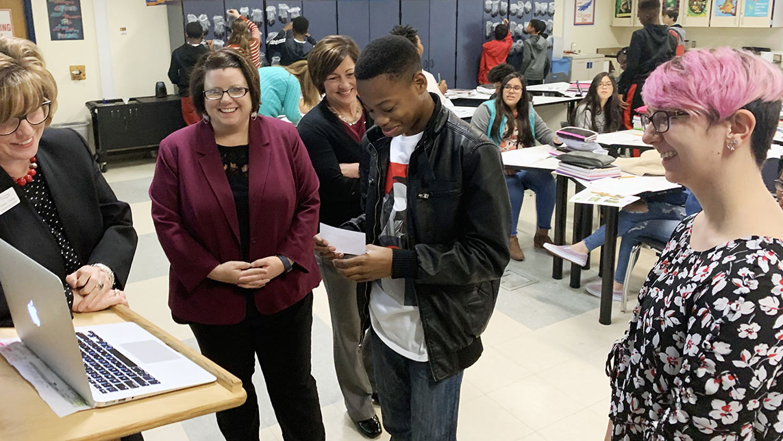 A photo of students talking to NC State Chancellor Randy Woodson