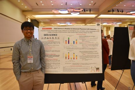 A photo of Andy Khounmeuang at the research symposium