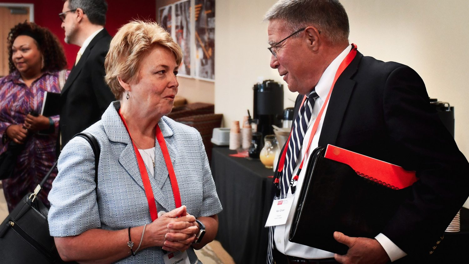 Two community college leaders talk during the statewide leadership conference on community college's impact on economic mobility.