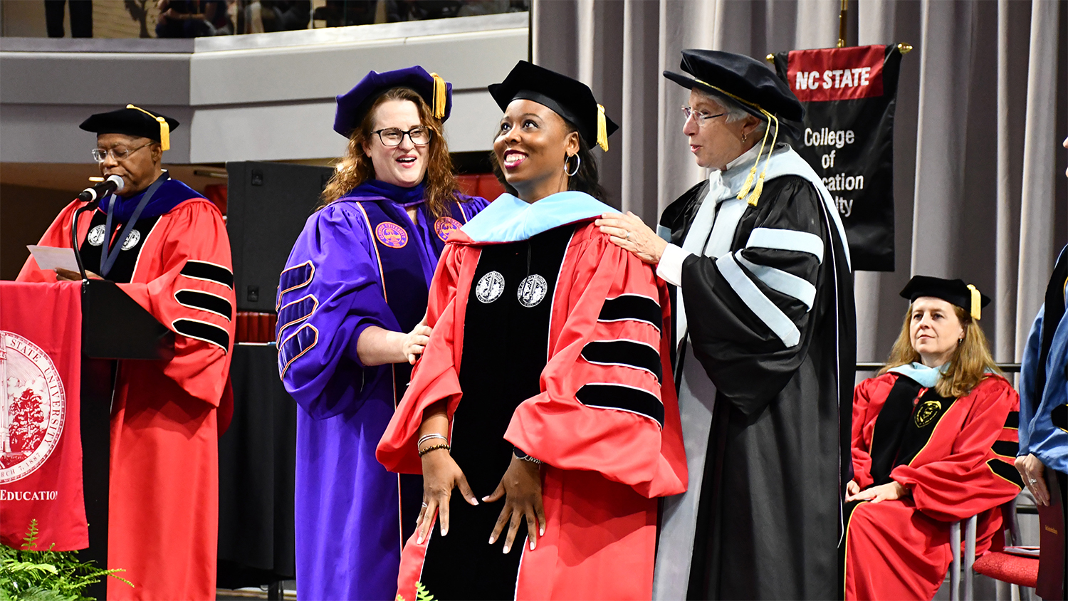 The hooding of a doctoral student during May 2019 Graduation.