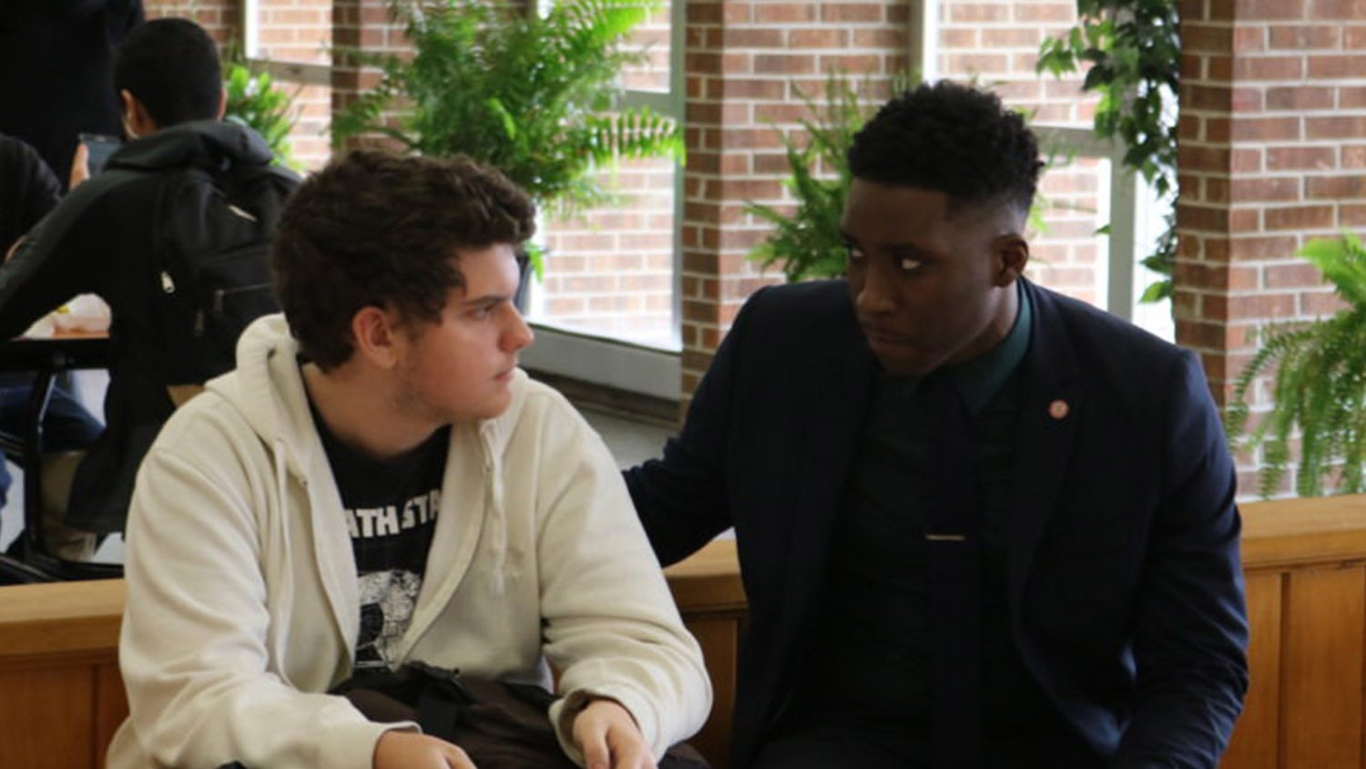 Principal Donnell Cannon, right, sits with a student at lunch at North Edgecombe High School.