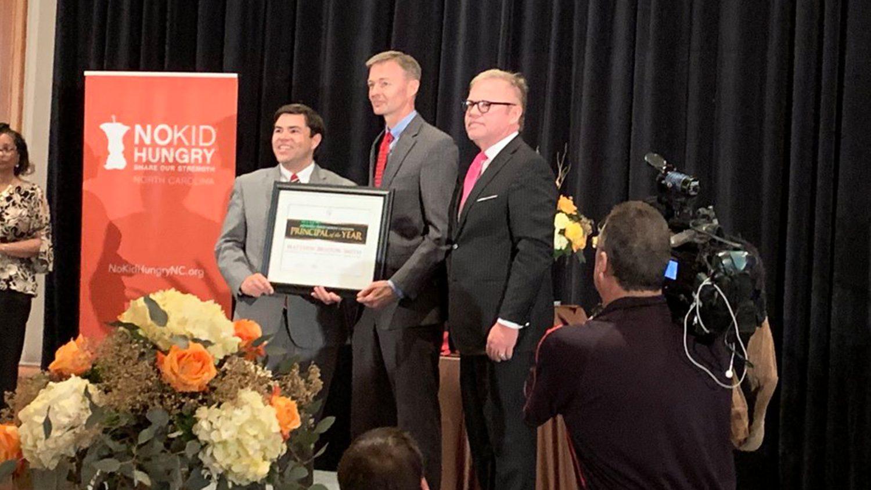 Matthew Bristow-Smith receiving his Principal of the Year award from North Carolina education leaders.
