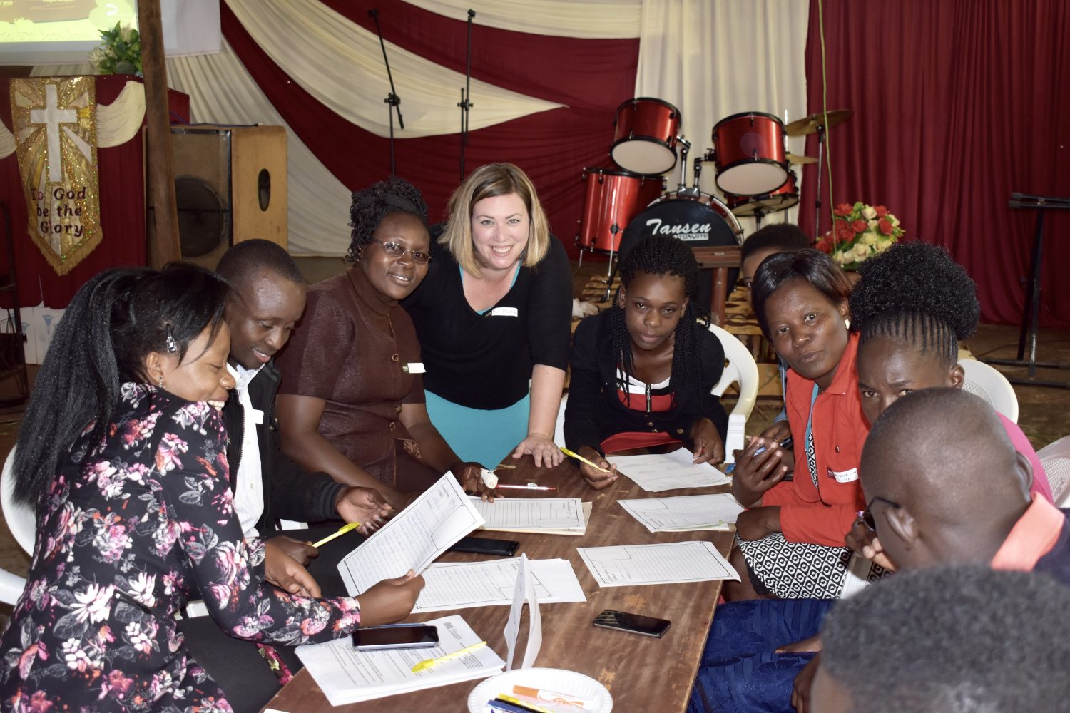 Michelle Falter, Ph.D., surrounded by teachers in Kenya