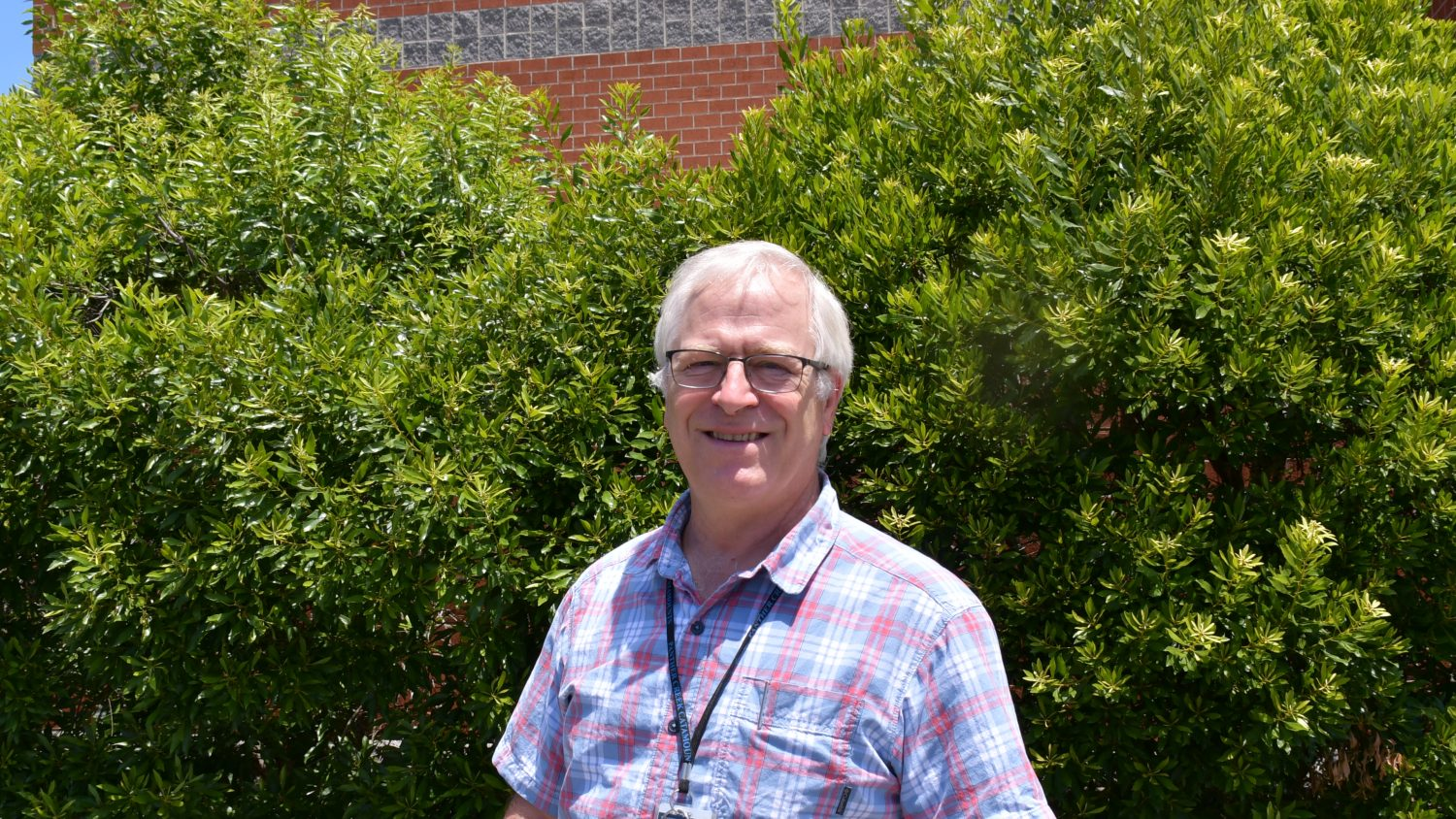 Joe Busby '99EDD stands outside his classroom at Panther Creek High School in Cary