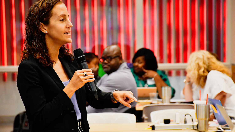 Dr. Ann Harrington speaks during a series of Wolfpack WORKS meetings in June 2019