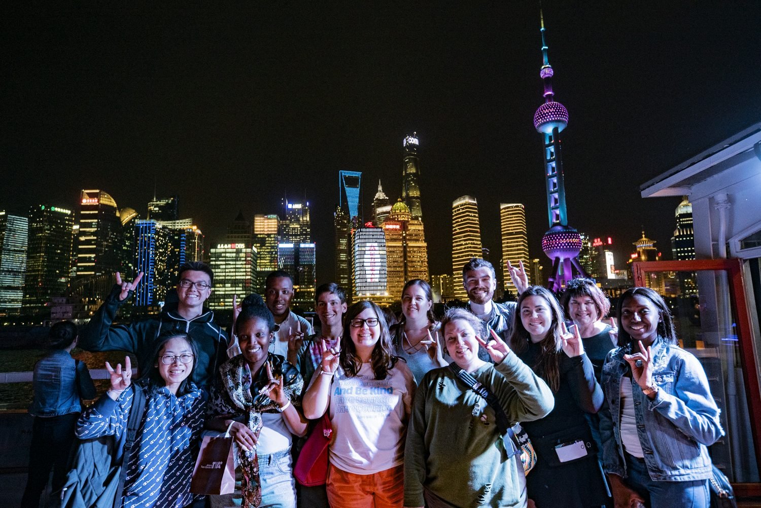 Dr. Hiller Spires in Shanghai with 11 students who participated in a study abroad course in May 2019.
