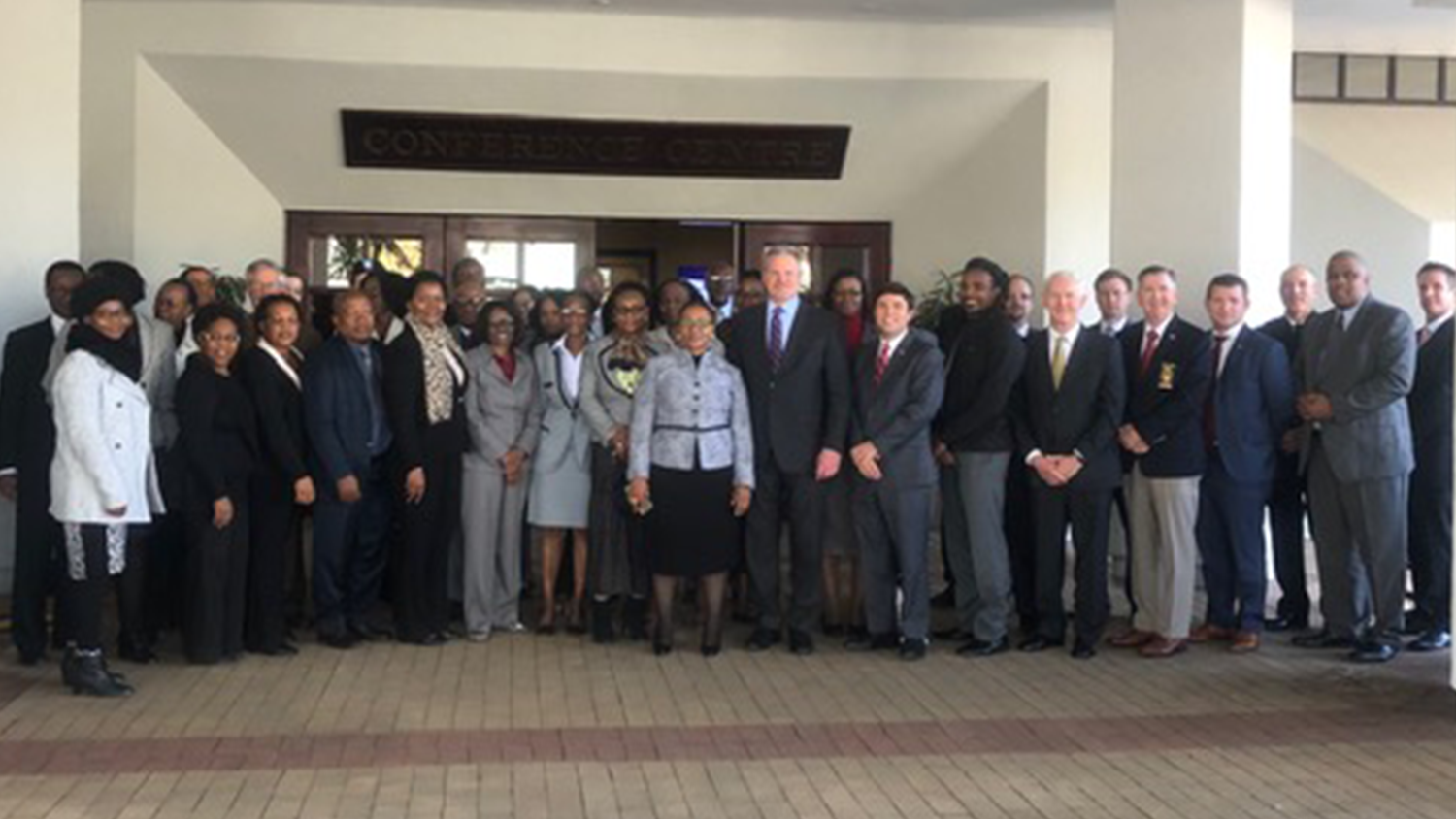College of Education Associate Professor poses with others in Botswana