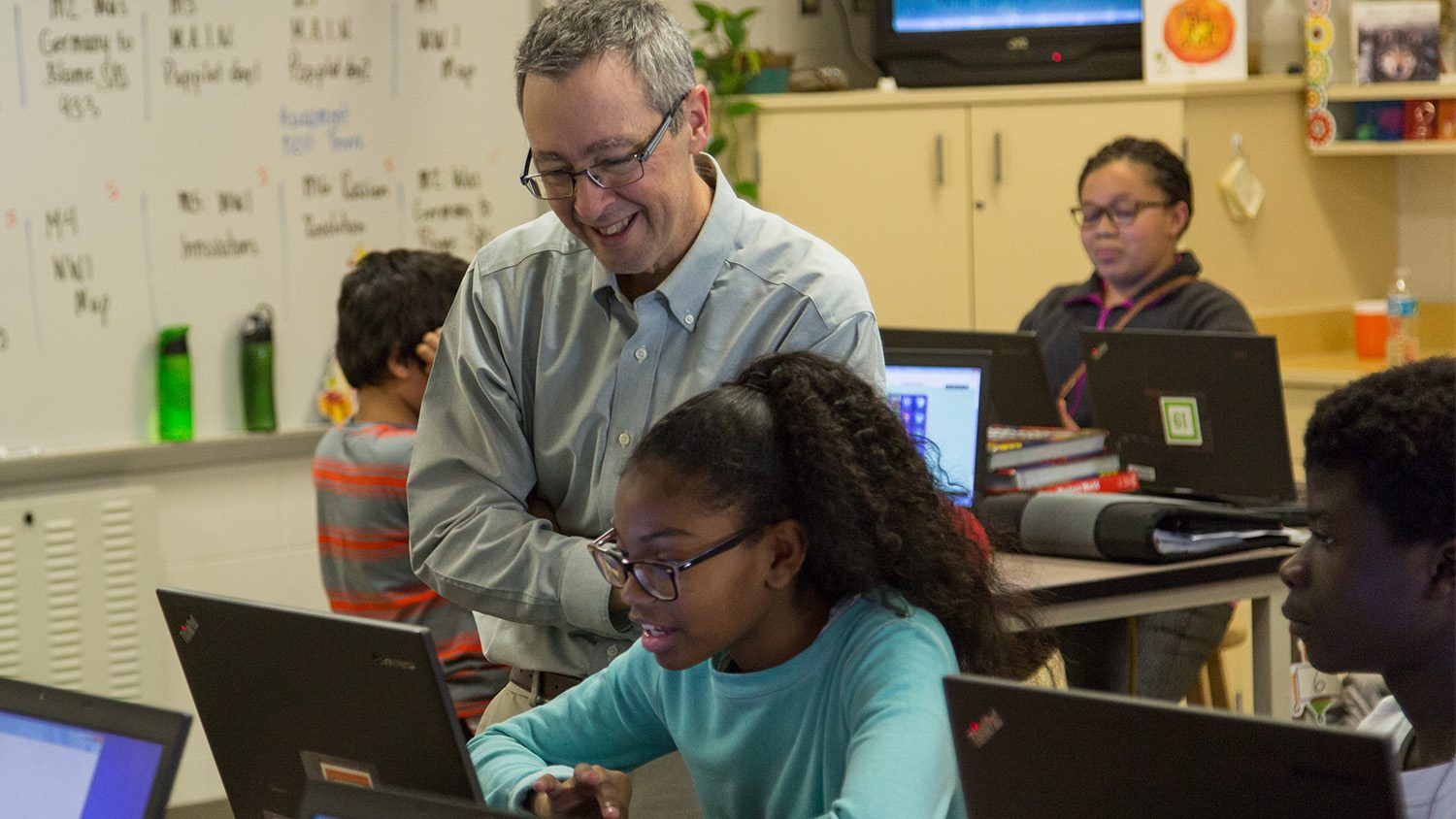 NC State College of Education Professor and Friday Institute Fellow Eric Wiebe works with students at Centennial Campus Middle School.