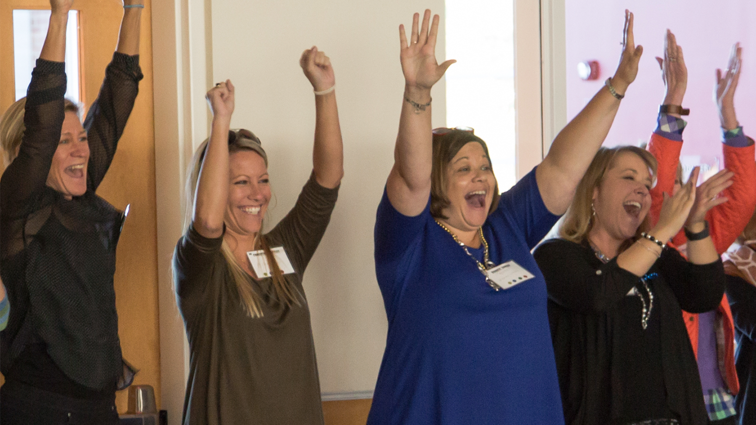 Educators cheer at a gathering of the North Carolina Digital Leaders Coaching Network.
