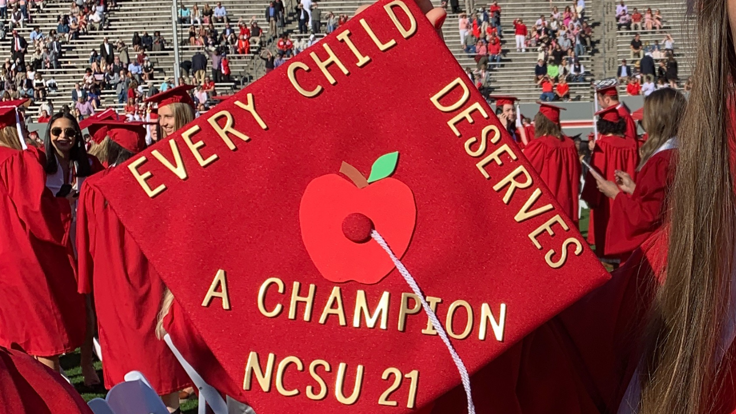 Graduation cap with message that every child deserves a champion