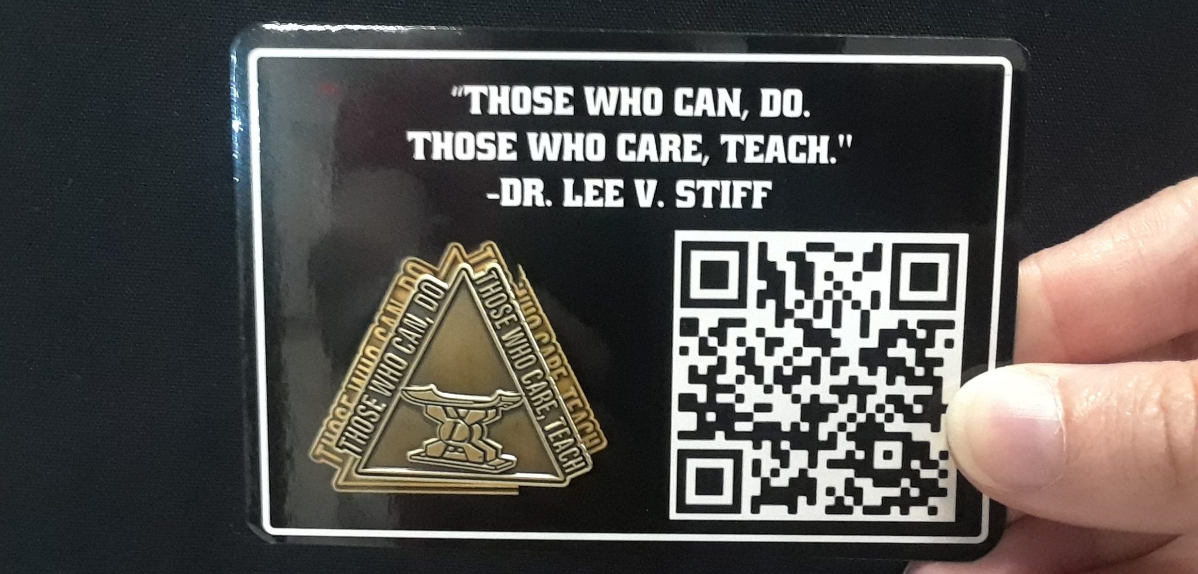 """A pin worn by NC State College of Education faculty in honor of Lee V. Stiff, Ph.D. says """"those who care, teach."""""""